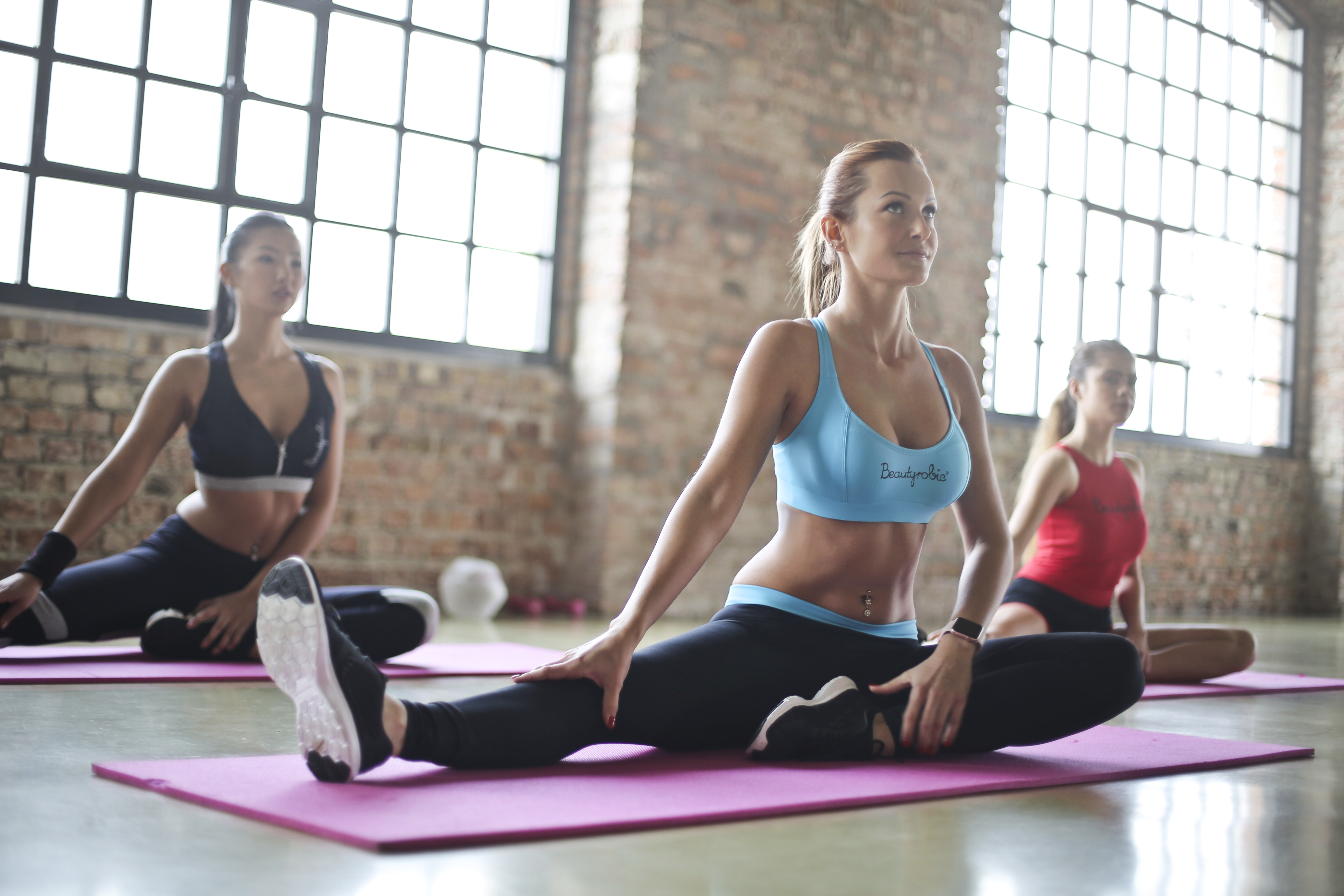 Canva - Three Woman Doing an Exercises